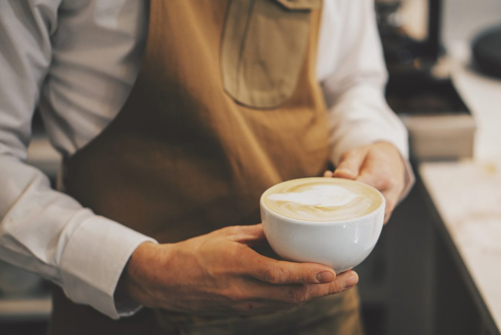 Team member serving coffee at Rheged